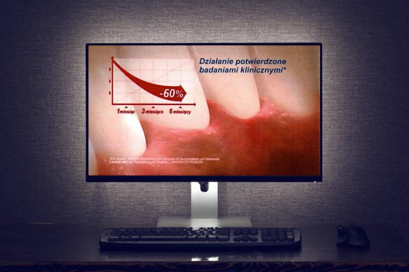 Zdjęcie monitora z reklamą Lacalut Active.